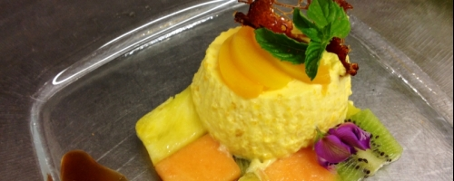 Peach bavarese with fruit chessboard